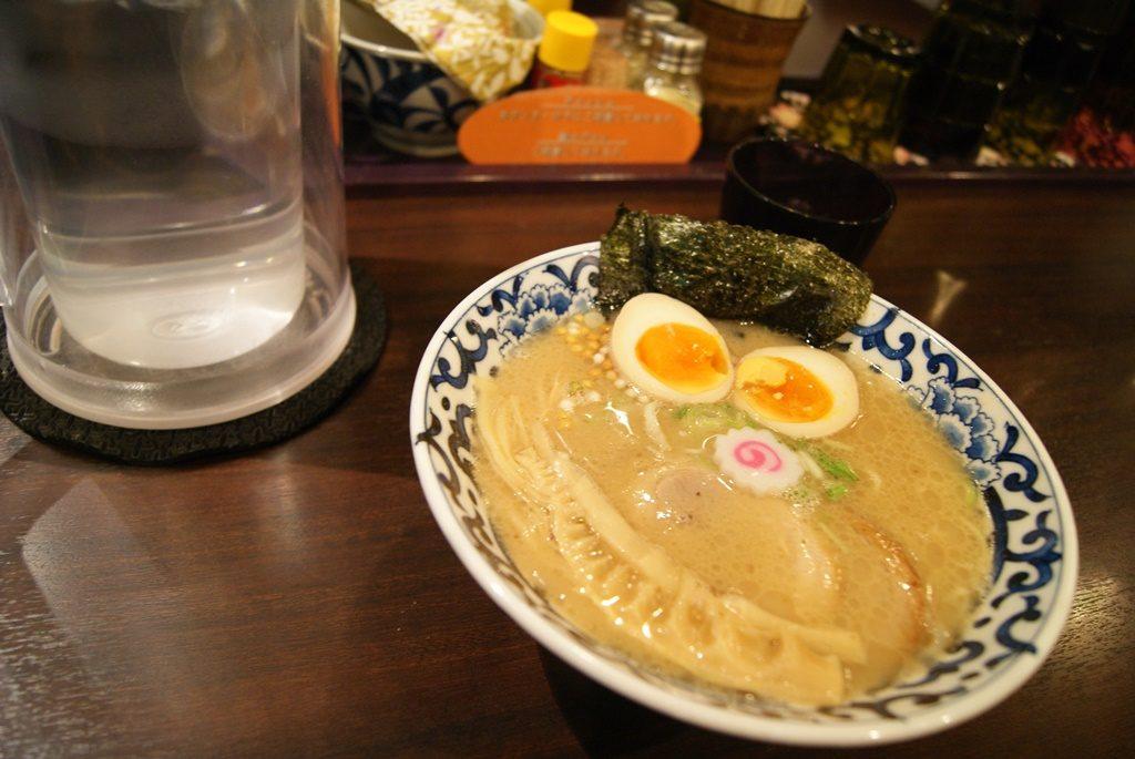 Pork bone broth ramen or tonkotsu ramen with eggs and seaweed in tokyo travel guide