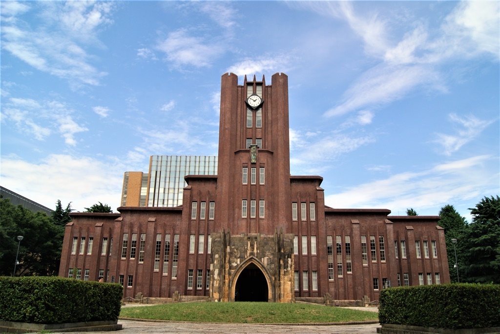 tokyo university main building clock tower under blue sky cheap things to do in tokyo