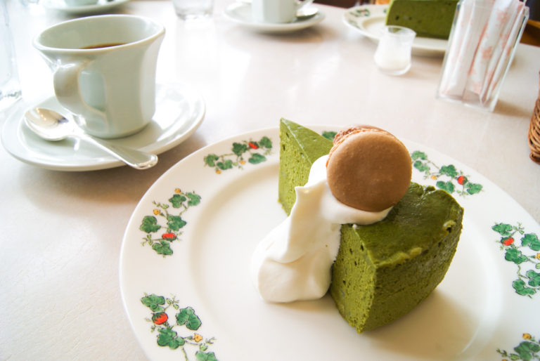 matcha cake with cream and macaron with tea at afternoon tea at Rokkatei sapporo travel guide