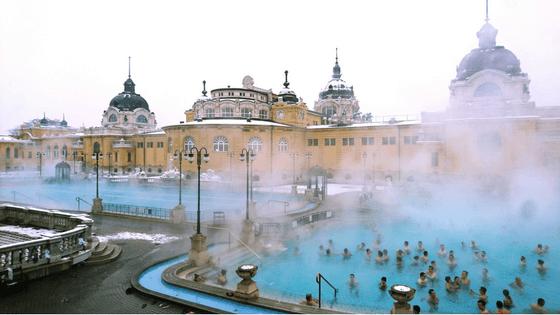 visit budapest in Winter, snow, szechenyi bath, szechenyi bath in winter, turkish bath, tourist spot, roman architecture