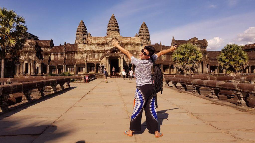 Posing in front of Angkor wat at sunrise