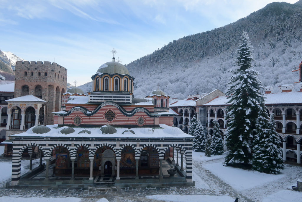 Sofia to Rila monastery in snow with snowy mountains and christmas tree
