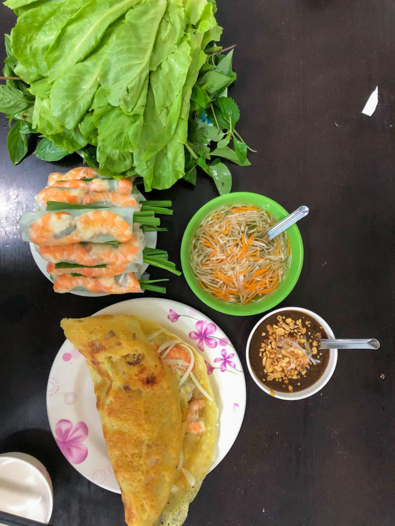 vietnamese sizzling pancake with peanut sauce and dressing best restaurant in ho chi minh city