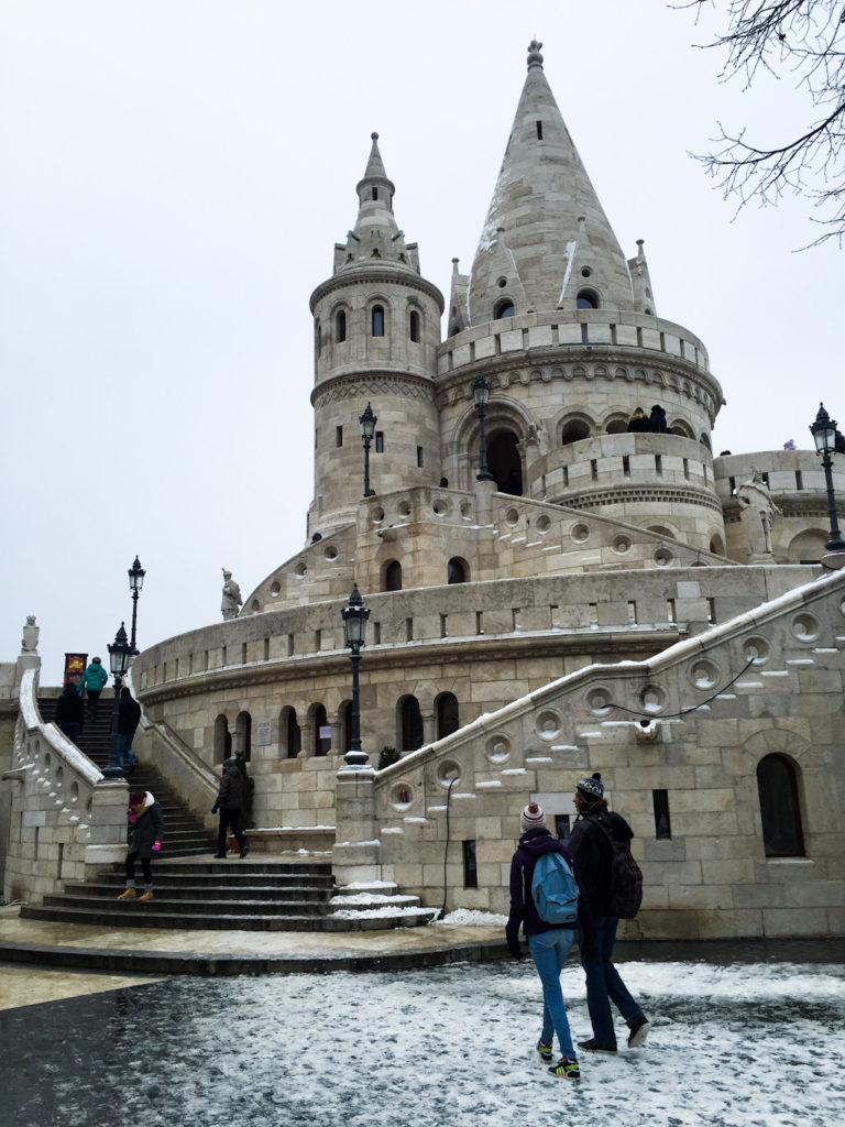 two travellers walking in front of fisherman's bastion