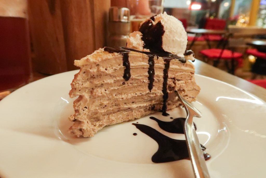 crepe cake with chocolate syrup and ice cream drum cafe budapest