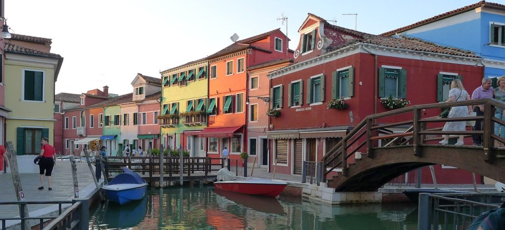 burano italy at near sunset with boats and colourful houses